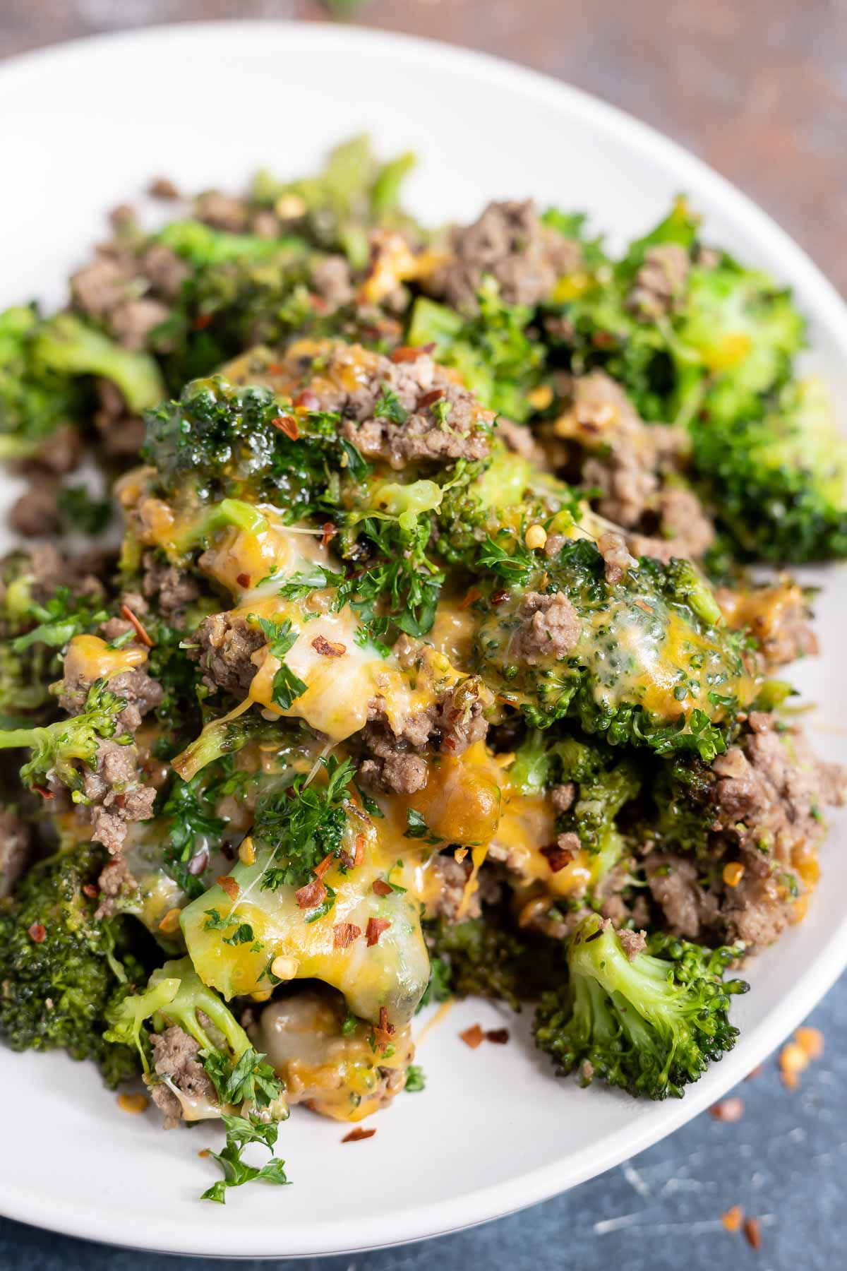 cheesy broccoli and beef served on white plate