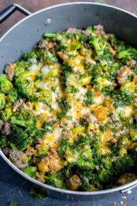 broccoli and beef topped with melted cheese in pot