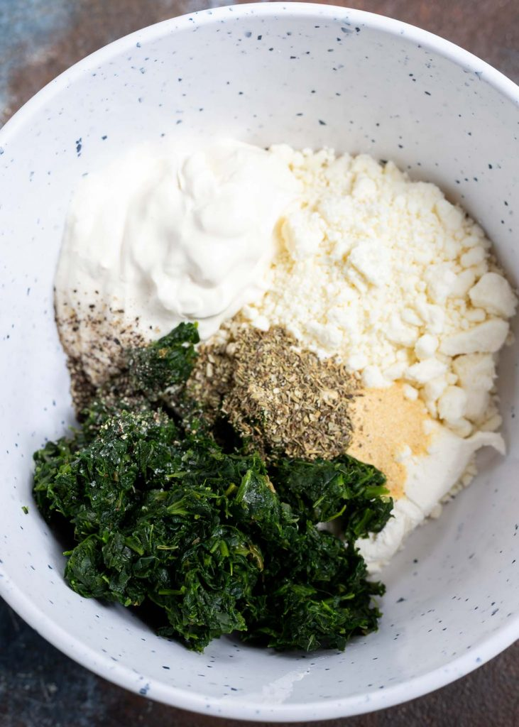 feta spinach dip ingredients in white mixing bowl