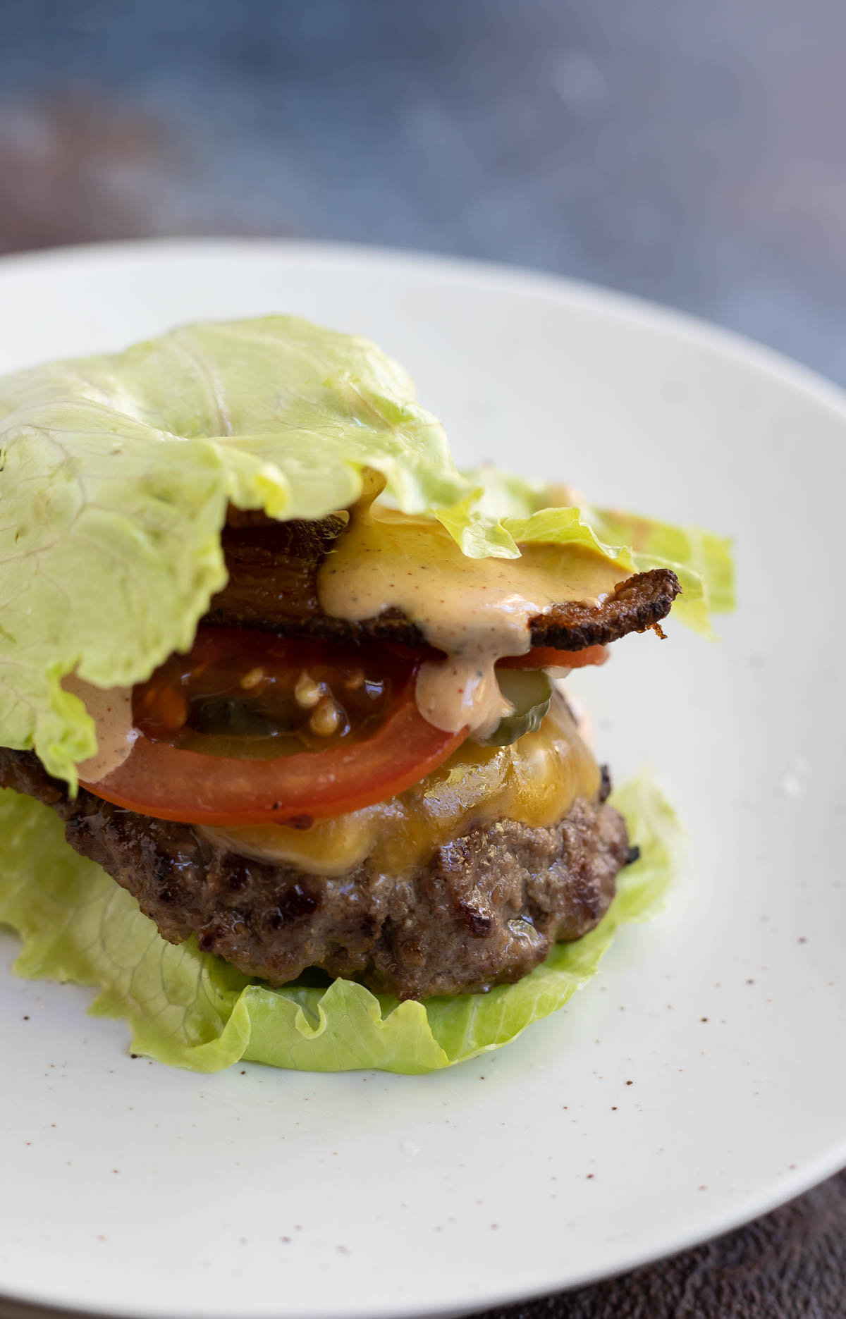 lettuce wrapped cheeseburger on white plate