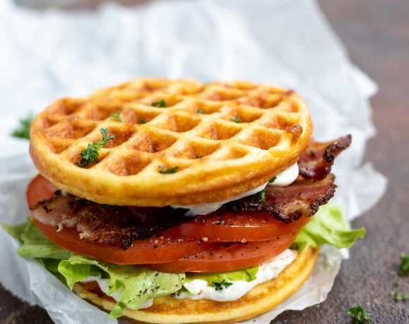 low carb waffle sandwich filled with tomato, bacon and lettuce