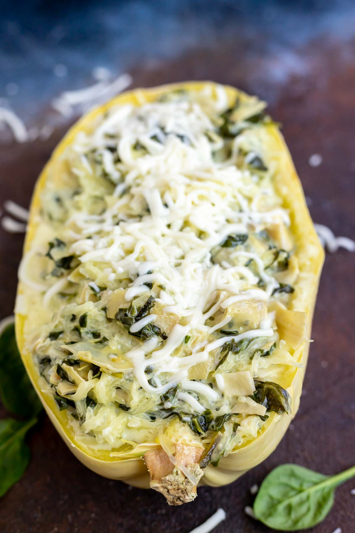 stuffed spaghetti squash topped with melted mozzarella