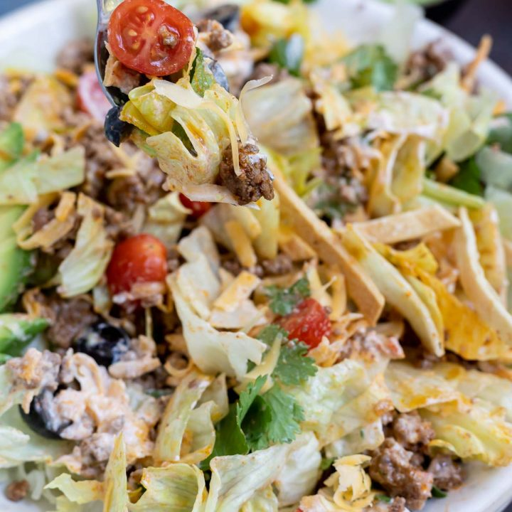 mixed taco salad, fork with taco salad on it