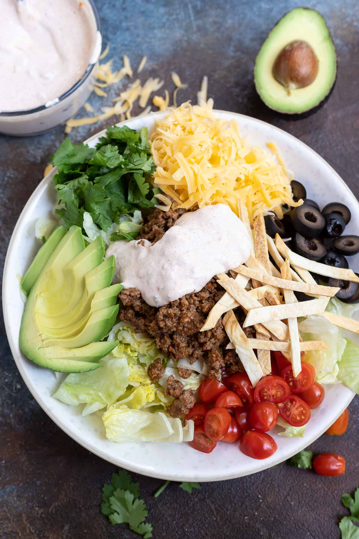 taco salad topped with creamy dressing