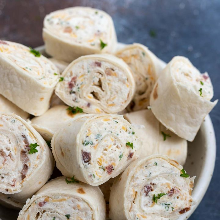 cream cheese filled turkey roll ups served on white plate