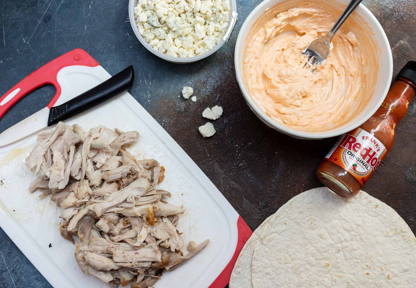 shredded chicken, blue cheese crumbles, tortillas and buffalo cream cheese mixture