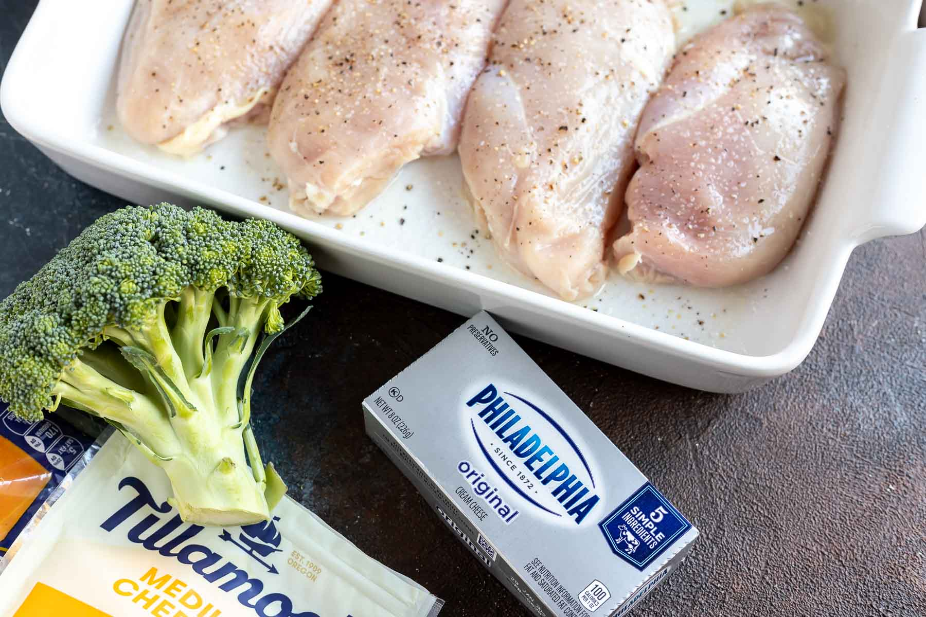 raw chicken, broccoli and package of cream cheese