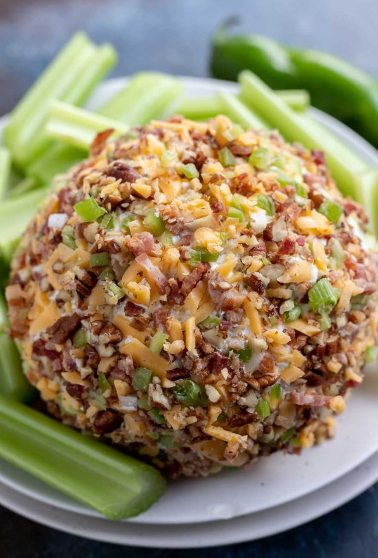 prepared cheese ball covered in cheddar, bacon and jalapeño