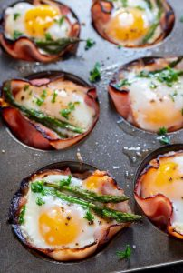 cooked asparagus ham and egg cups in muffin tin