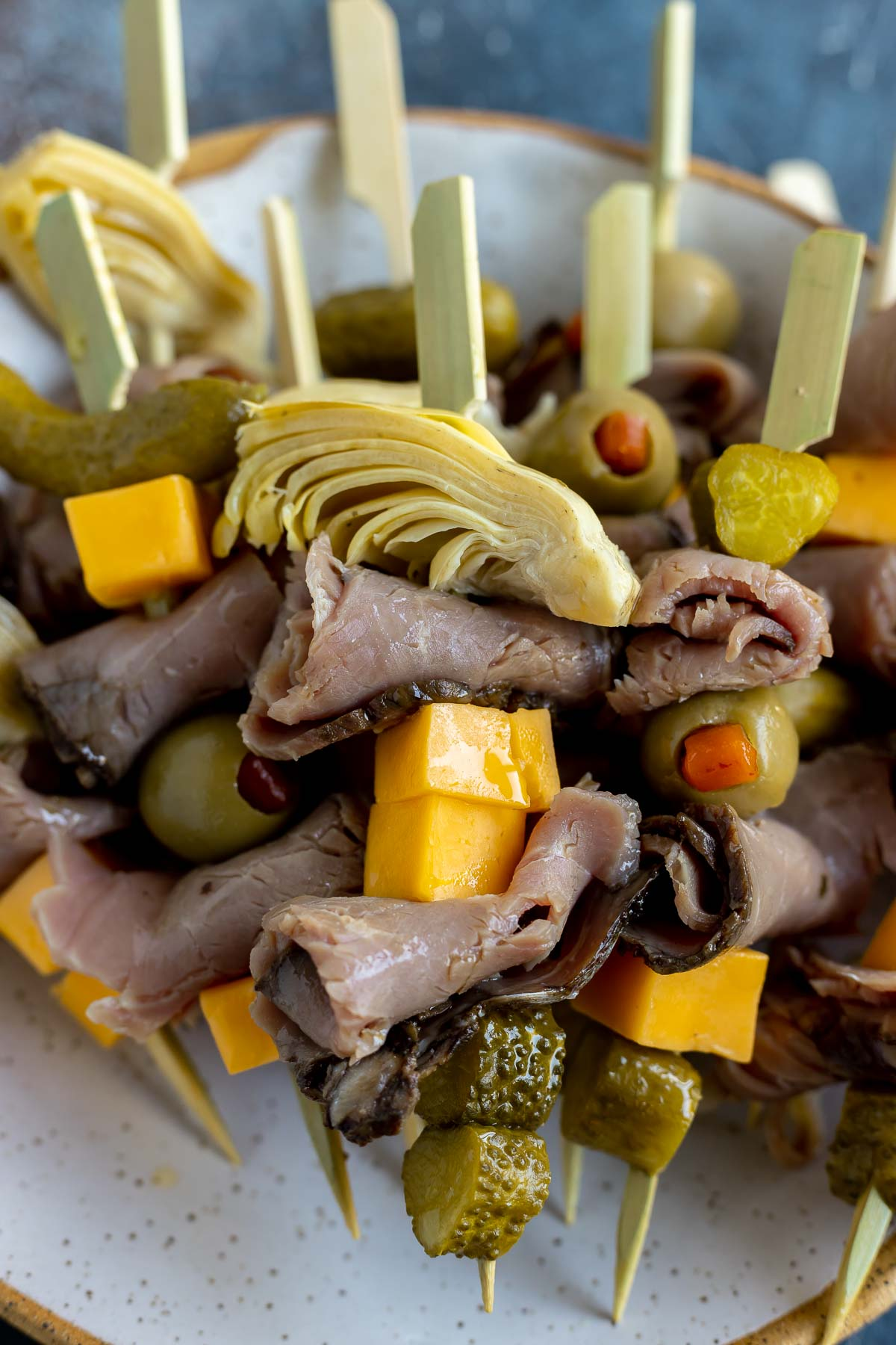 meat cheese olives and pickles on toothpick skewers
