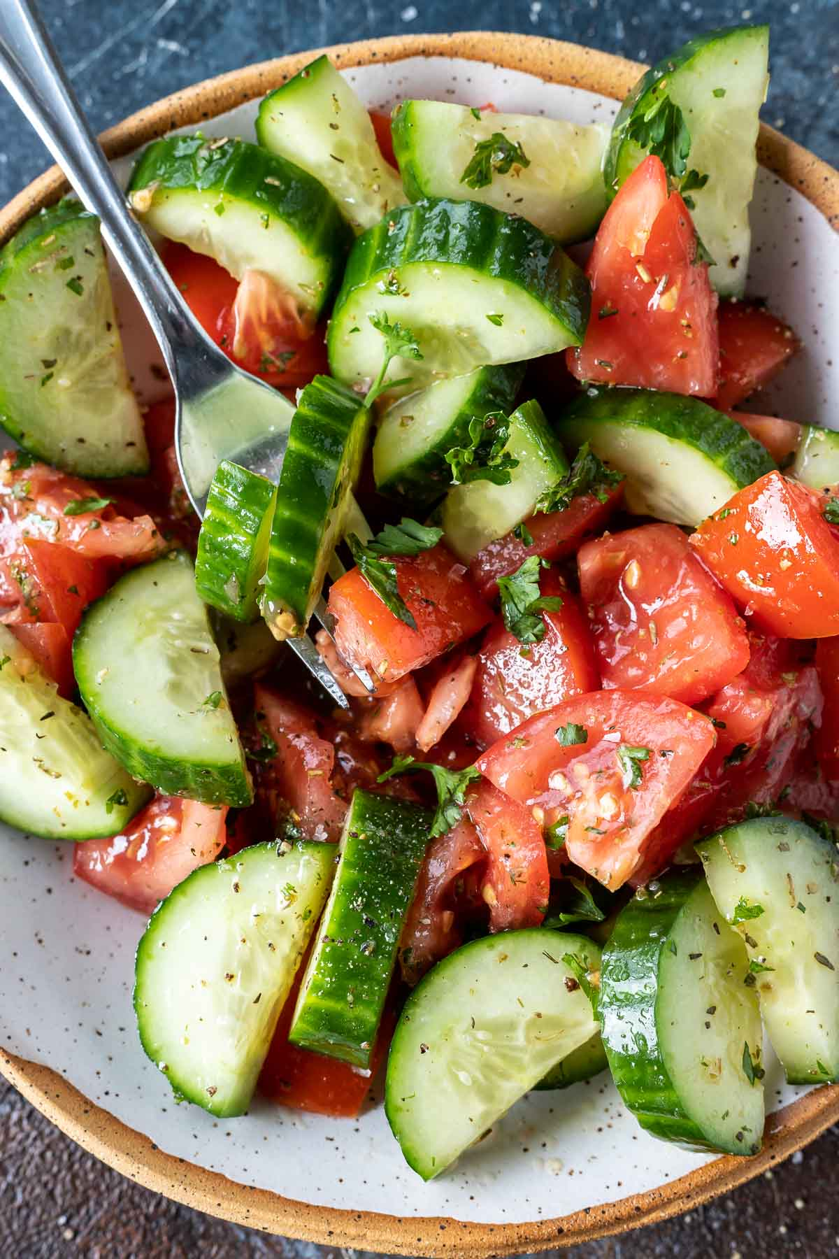 tomatoes and cucumber salad served in bowl